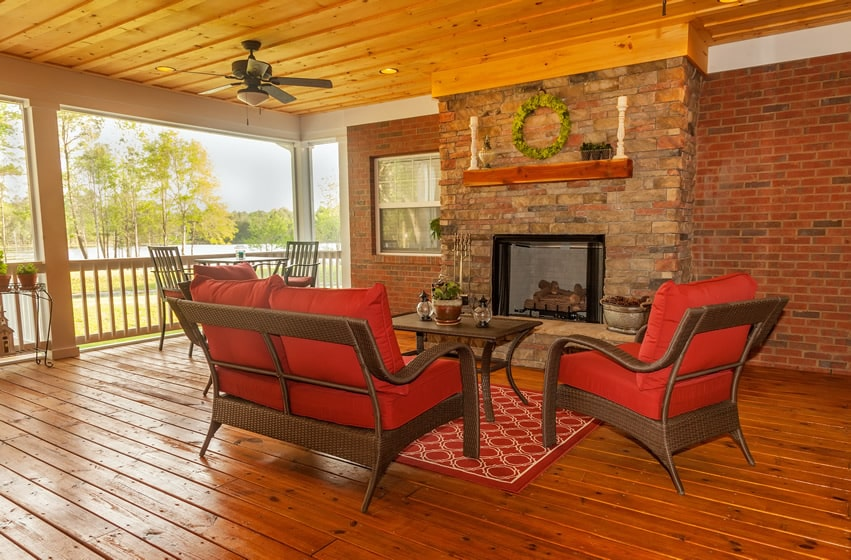 30 outdoor fireplace ideas with pictures designing idea for Covered porch with fireplace