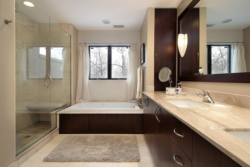 Master bath in luxury home with dark paneling
