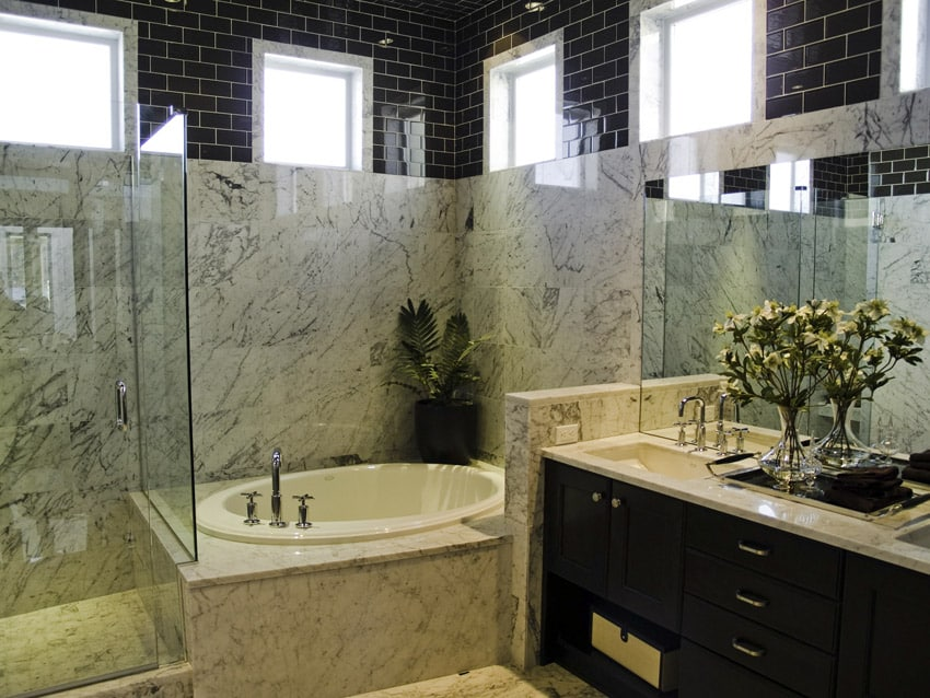 Very large bathroom with upper wall in black subway tile