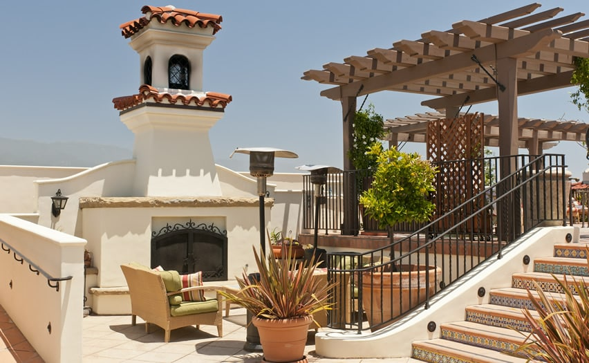 Grand spanish style outdoor fireplace with stucco