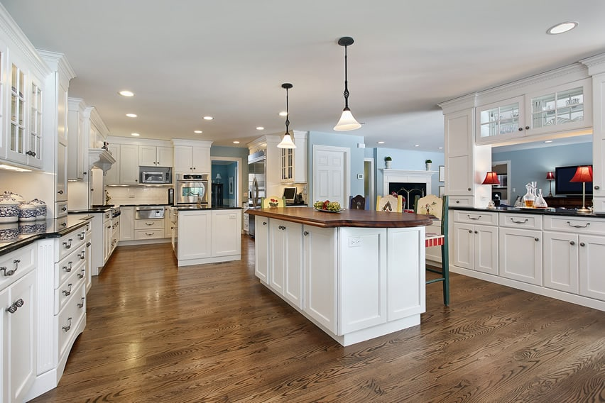 Huge luxury white kitchen with two islands
