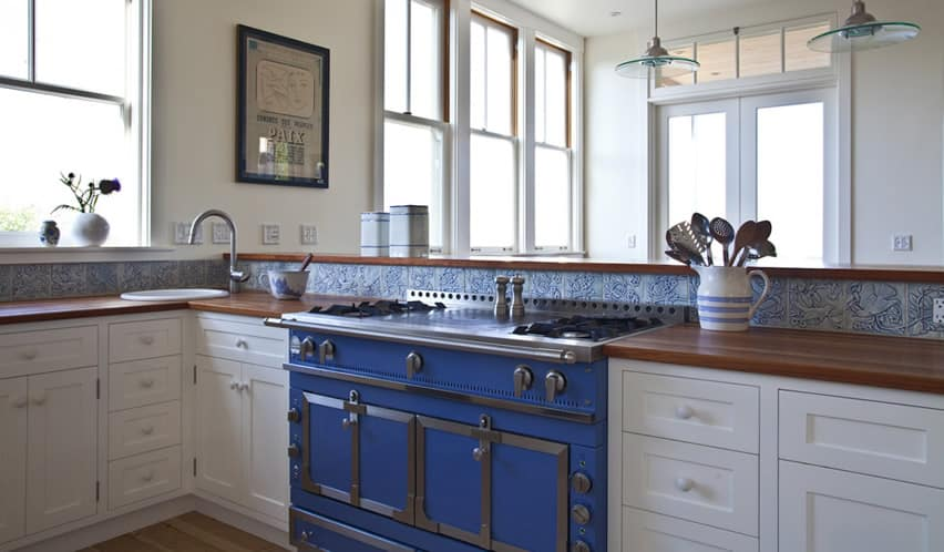 Kitchen with blue color gas stove and blue back splash