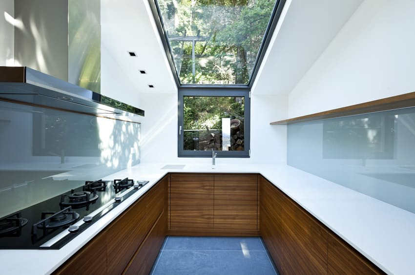 Kitchen with skylight and blue floor and back splash
