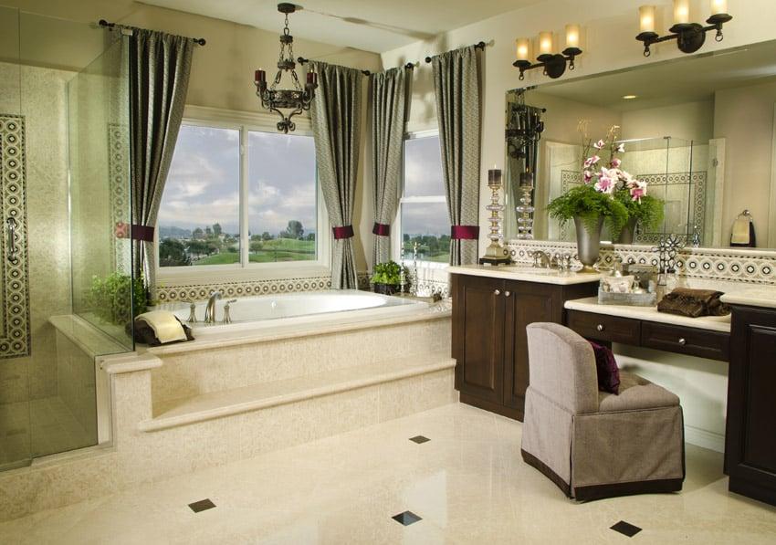 Large designer custom bathroom with makeup area