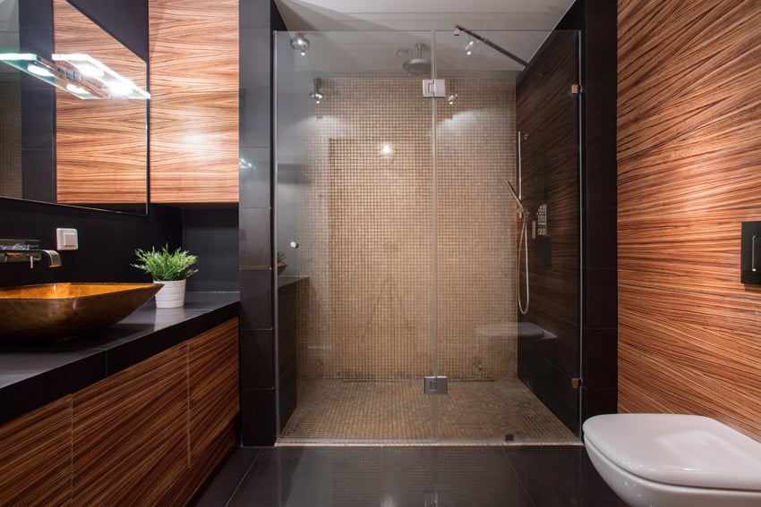 Large glass shower in bathroom with mosaic tiles