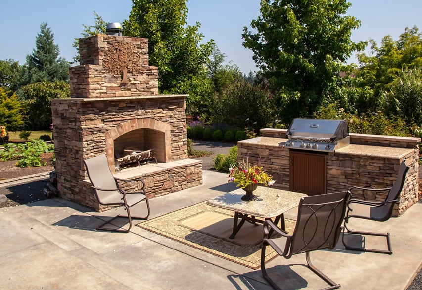 Large stone fireplace and outdoor kitchen