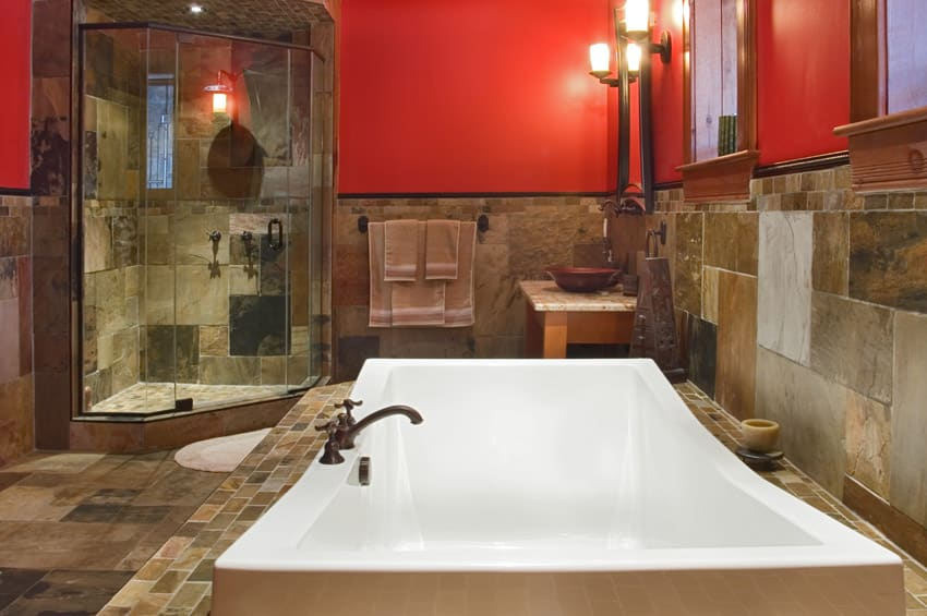 Luxurious tub in bathroom with red walls