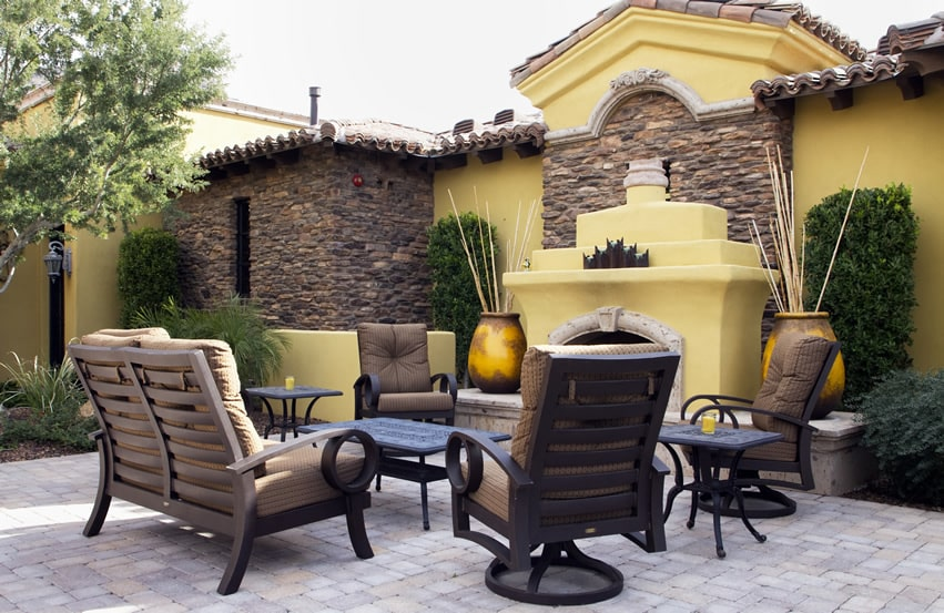 Luxury outdoor fireplace sitting area in yellow