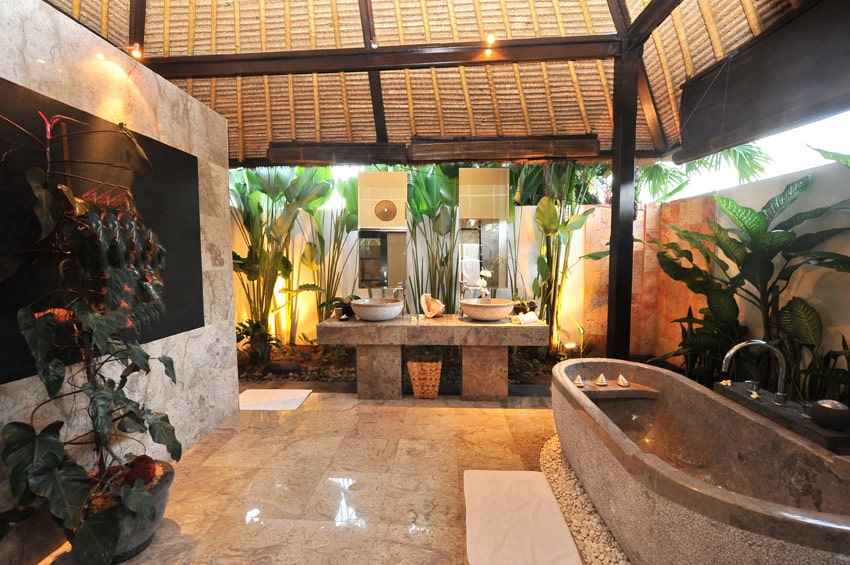 Luxury resort bathroom in tropical setting with vaulted ceiling