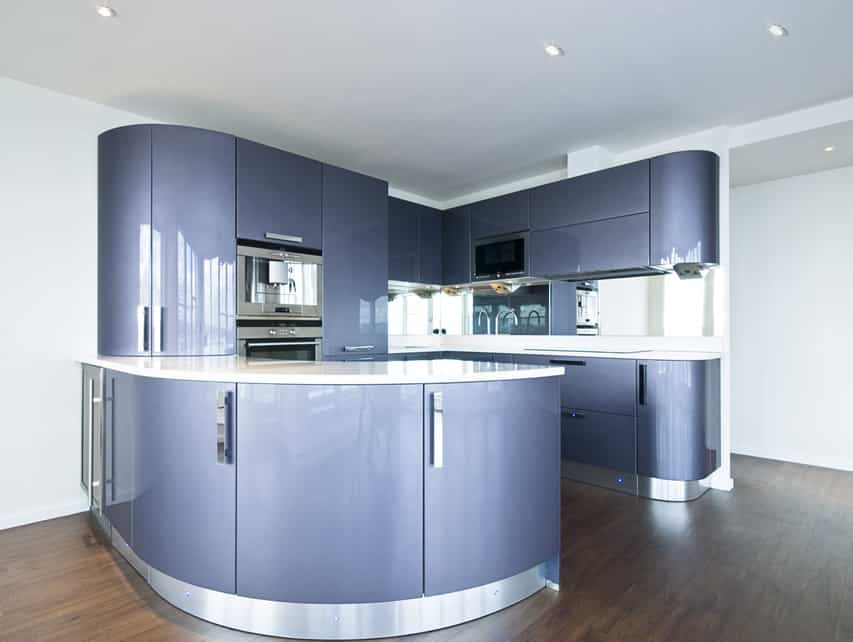 Ultra modern blue kitchen with curved counter top