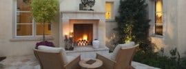 outdoor-fireplace-design-at-rustic-luxury-home