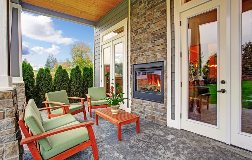 Outdoor fireplace on patio connected to house