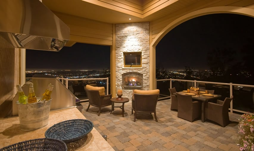 Outdoor fireplace with amazing city view at night
