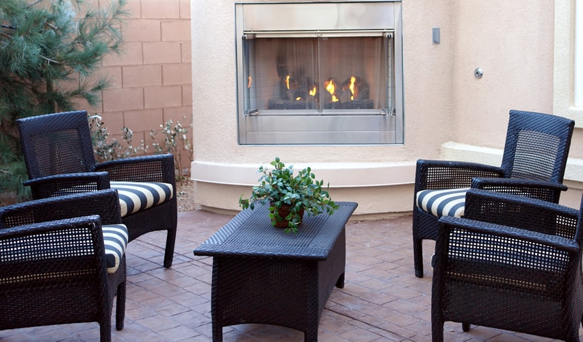 Patio area with fireplace and outdoor furniture