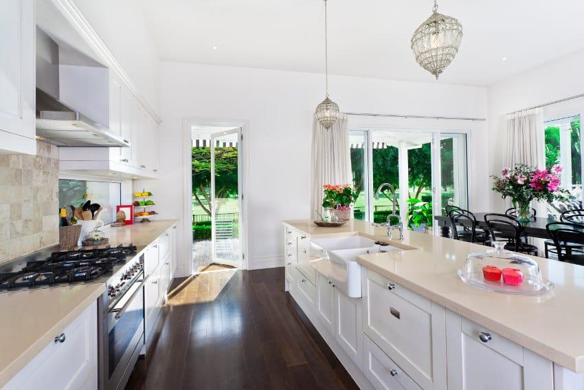 Stylish open plan kitchen with cream quartz counter