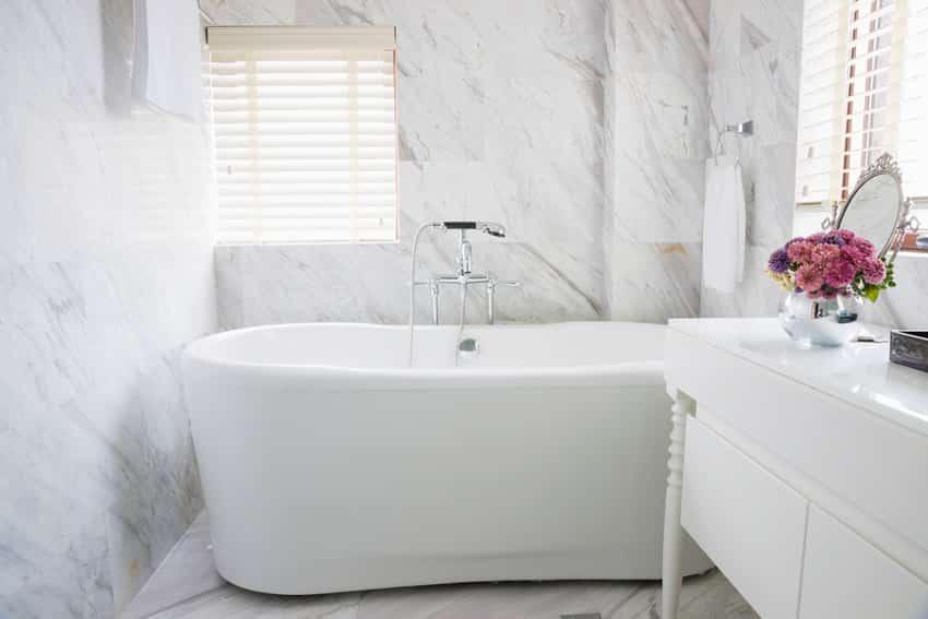 Small bathroom with tub and legged vanity