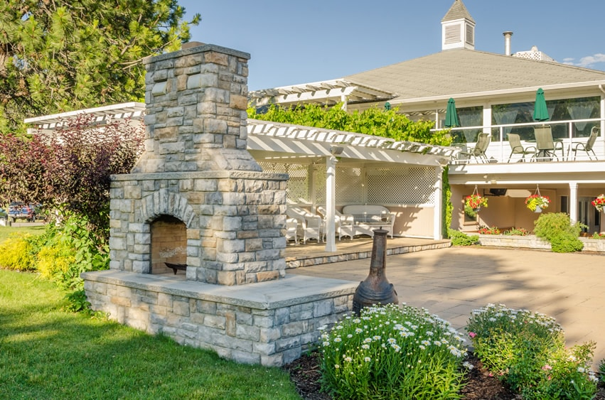 Stone fireplace in backyard of home