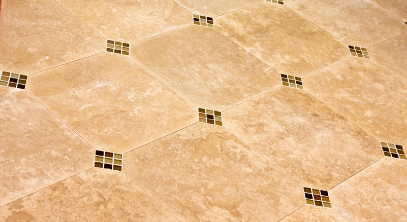 Travertine floor tiles with glass insertions