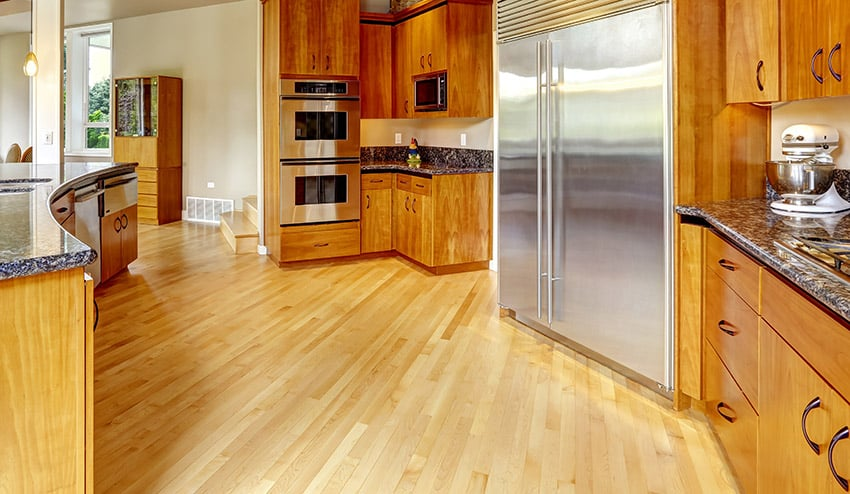 Wood flooring in kitchen with light color