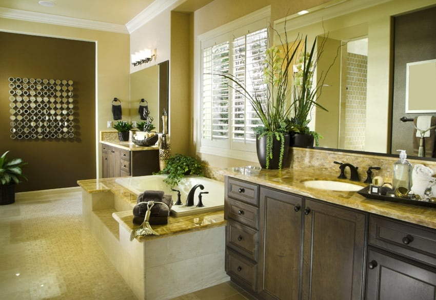 Yellow bathroom with wood cabinet storage