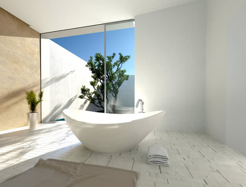 Zen design bathroom oasis with view of private outdoor area