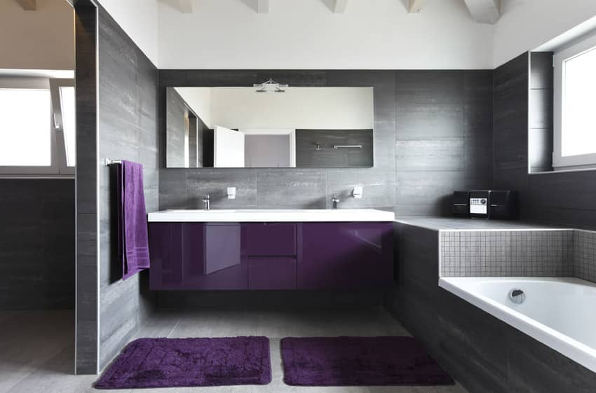 Bathroom with purple sink cabinet and grey theme
