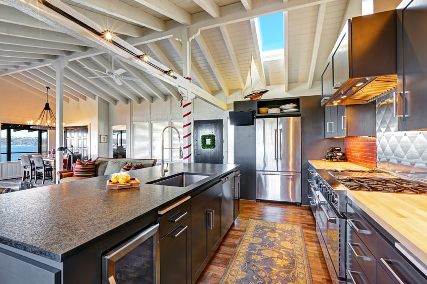 Beautiful custom chefs kitchen with large stainless steel oven