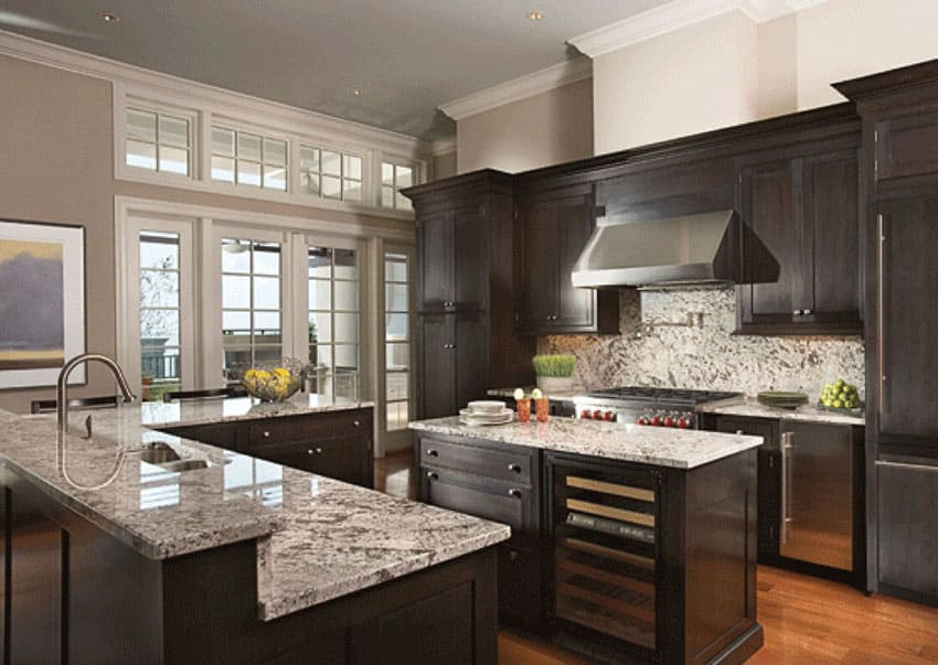 beautiful dark wood cabinet kitchen with light color granite counters