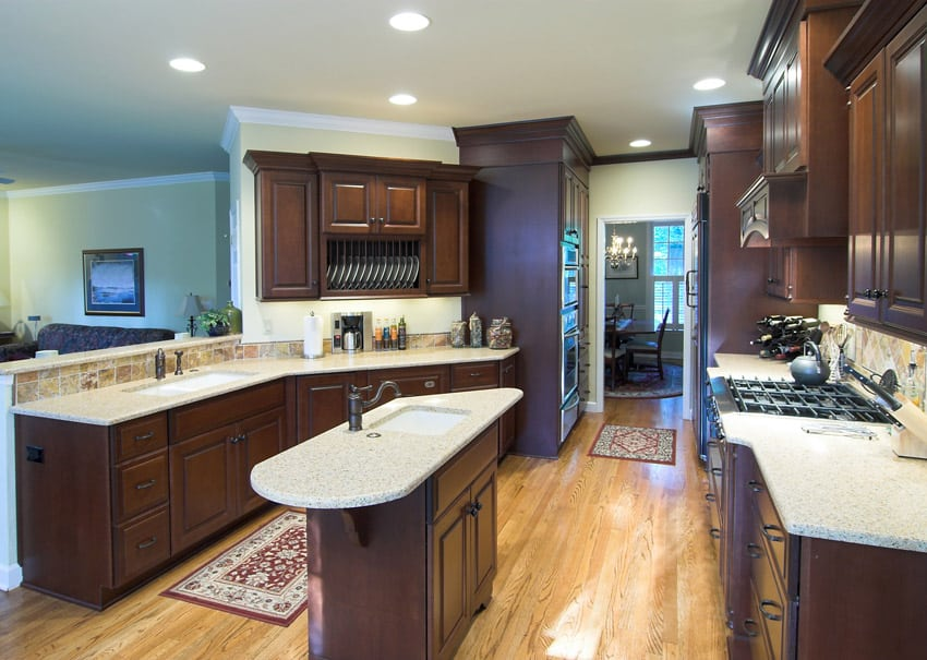 Beautiful light color counter kitchen with dark wood cabinetry