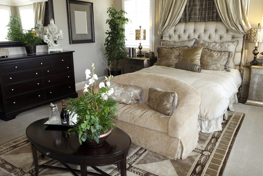 Beautifully decorated master bedroom with double bed chair