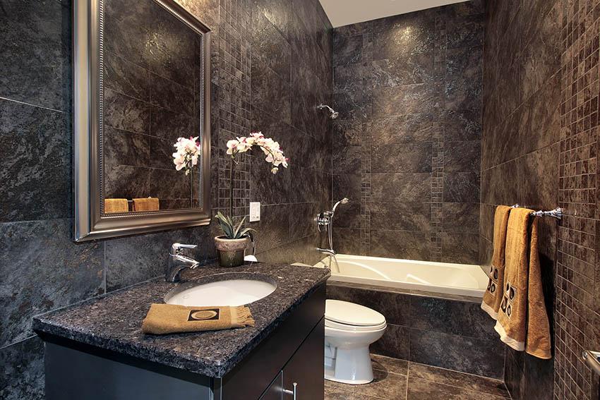 Luxury powder room with black granite walls