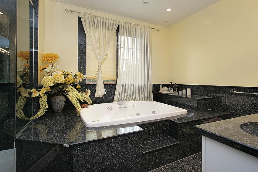 Master bath in luxury home in back marble