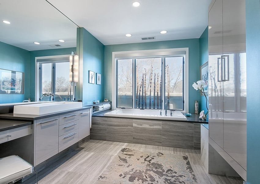 Contemporary master bathroom with slate flooring and enclosure
