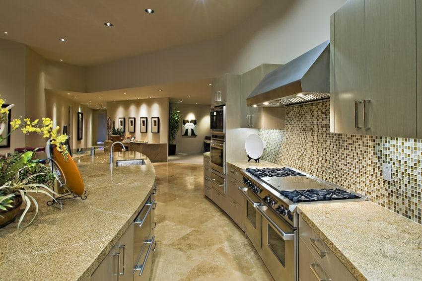 Curved counter kitchen with tile backsplash