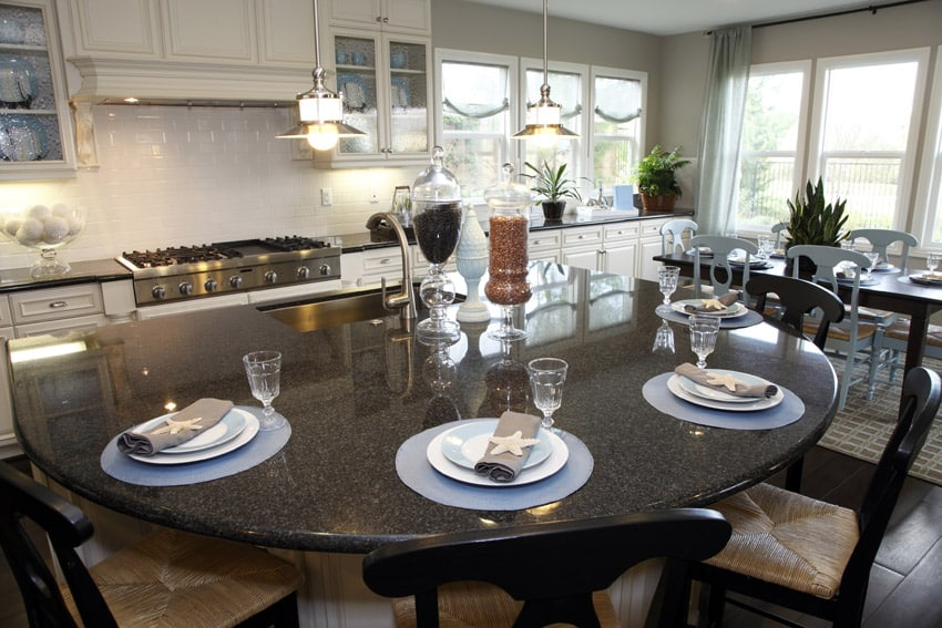 Curved eat in dining kitchen island with dark surface