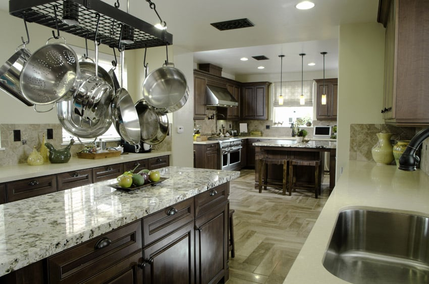 Dark Wood Cabinet Kitchen With Light Color Granite Counters