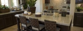 dark-wood-cabinet-kitchen-with-light-granite-counter-rattan-bar-stools