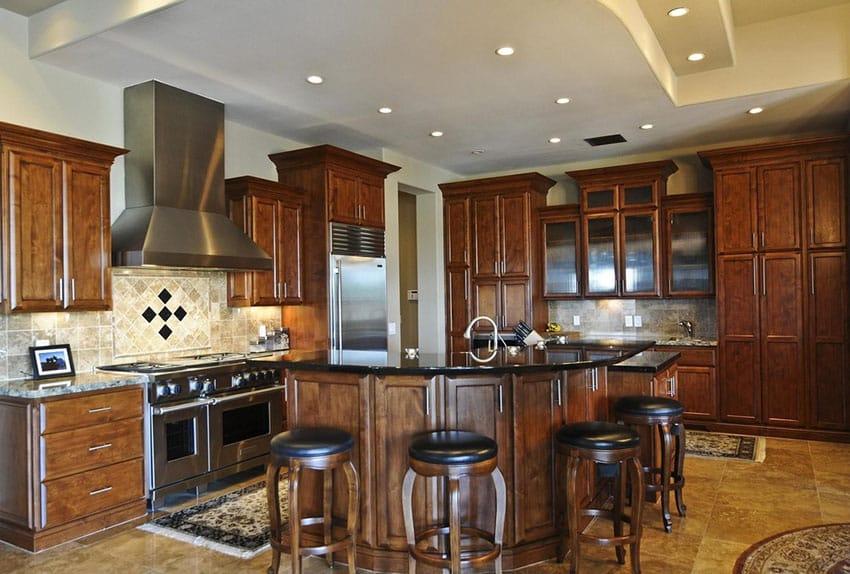 Designer wood kitchen with tile backsplash and eat in island for dining