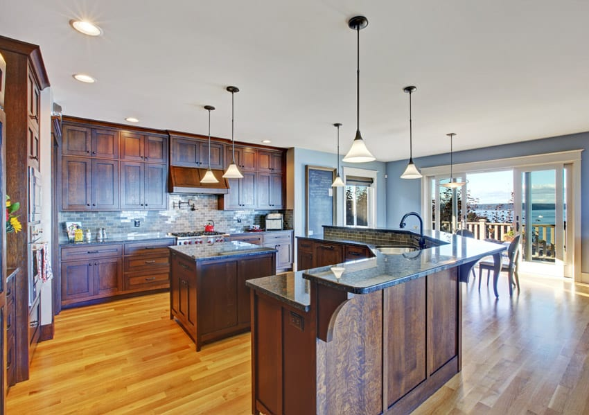 Custom wood kitchen design with two level countertop bar and square island
