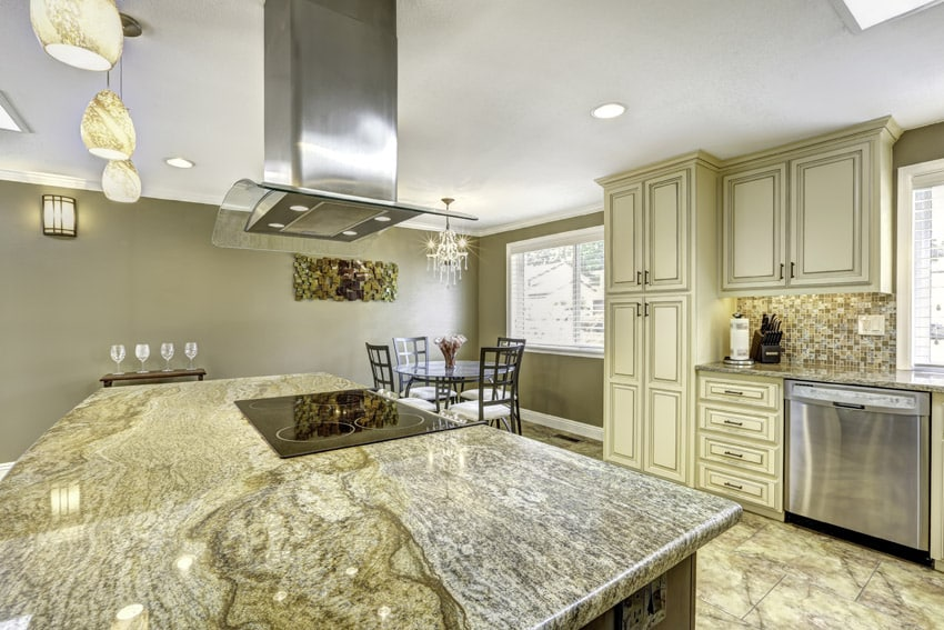 Gorgeous granite kitchen island with stainless oven hood