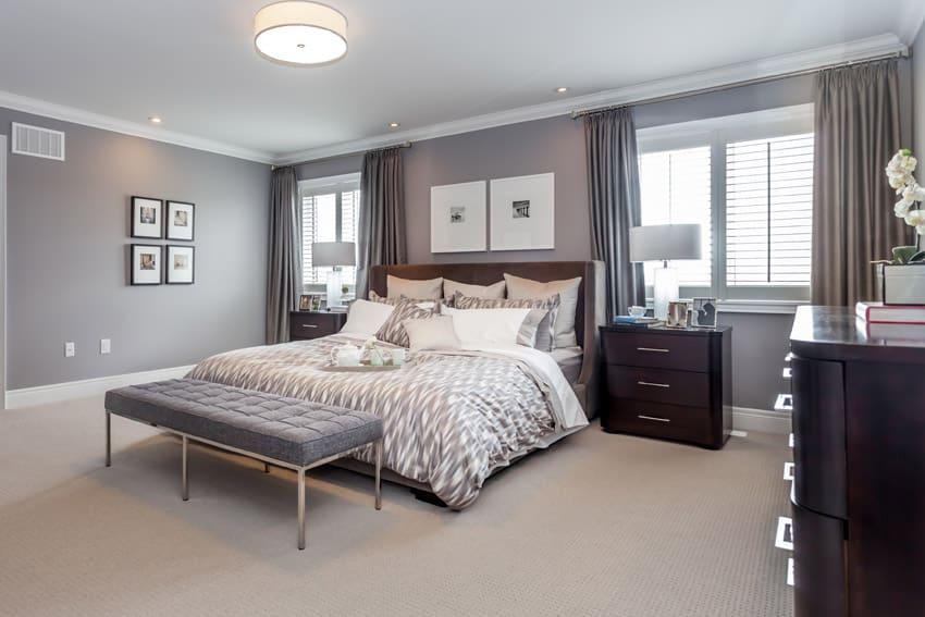 Grey walls tan carpet in master bedroom