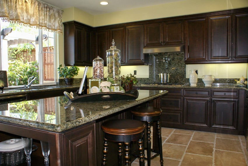 Intricate wood and granite kitchen island with green granite