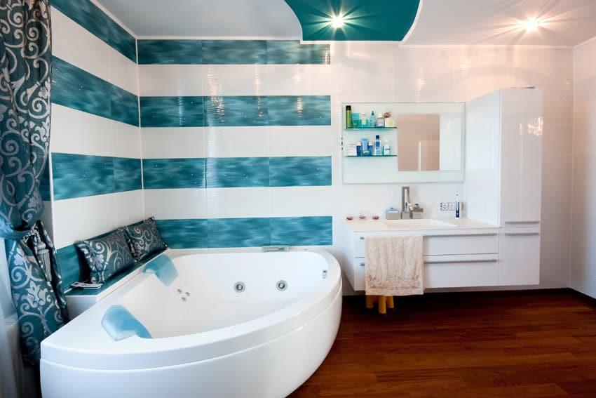 Jet bathtub in bath with blue horizontal stripes