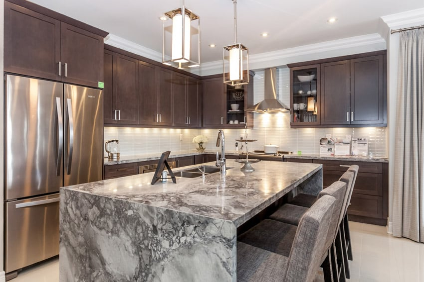Kitchen with soapstone island with eat in dining