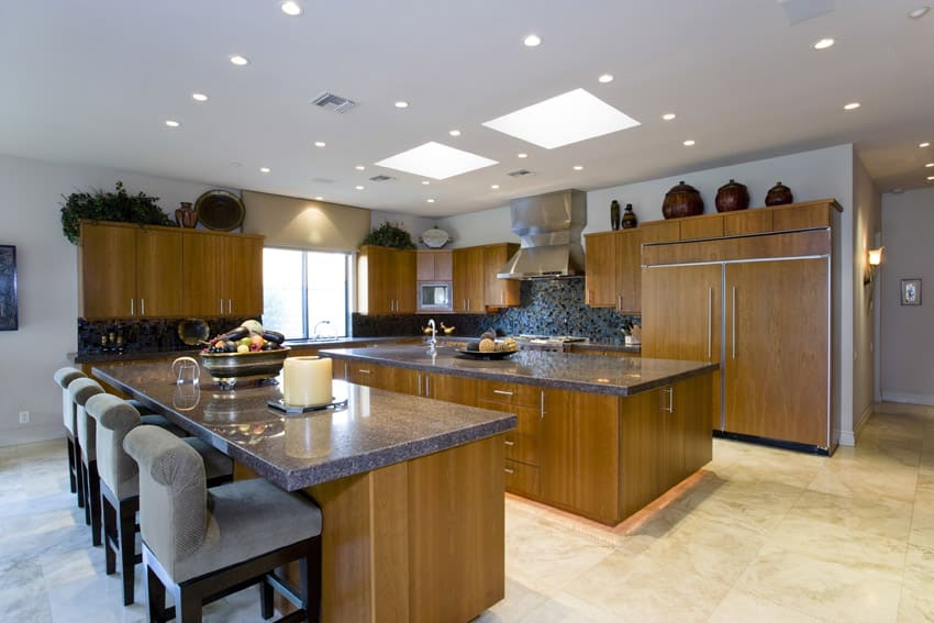 Kitchen with thick slab granite counter eat in dining