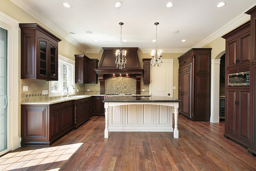 Large kitchen with two tone wood color
