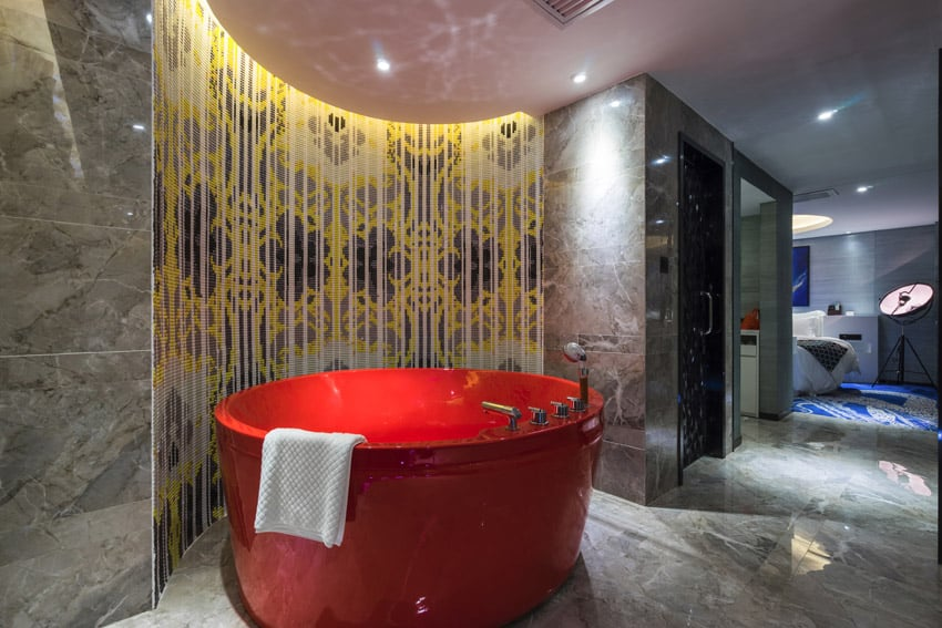 Large red tub in decorated bathroom
