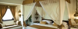 luxurious-four-post-bed-with-sheer-curtains