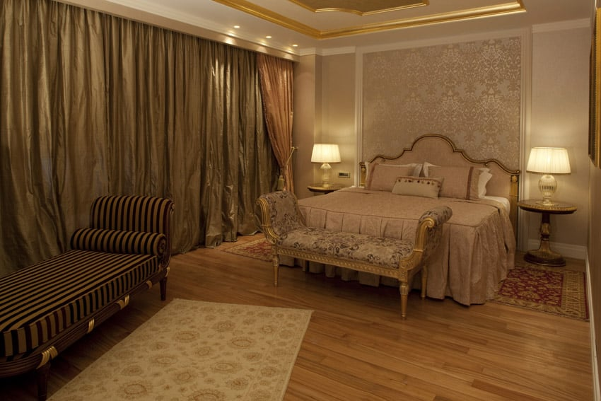 Luxury bedroom design with lounge seat