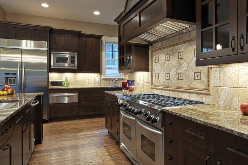 Luxury kitchen with custom tile backsplash